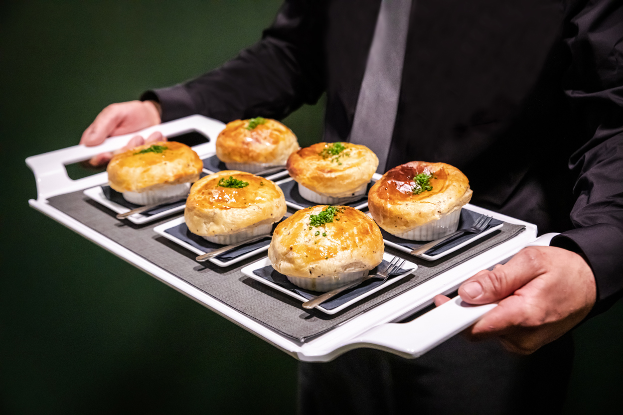 wolfgang puck catering dishes being served